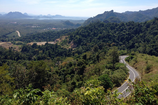 a few hairpins up the hill from immigration and you see Malaysia